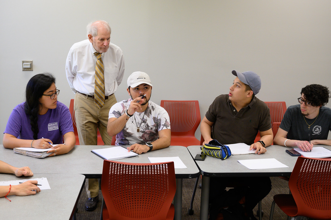 Professor Uri Treisman working with a small group of students