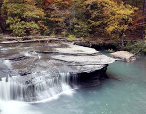 Haw Creek waterfall during peak autumn/fall colors in Pelsor, Arkansa.