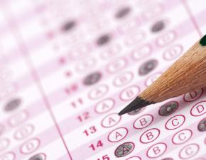 A standardized test paper with a pencil in closeup.